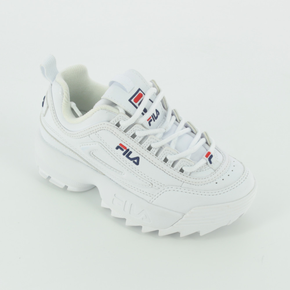 scarpe della fila da bambina